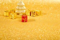 Golden christmas fir tree Stock Images
