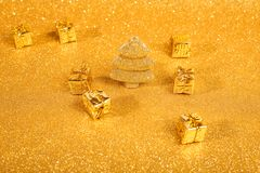 Golden christmas fir tree. And gifts decoration on glitter background Stock Photography
