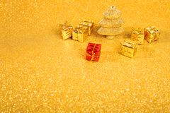 Golden christmas fir tree. And gifts decoration on glitter background Royalty Free Stock Photography