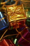Golden Christmas gift. Macro picture of golden Christmas gift decoration stock photos