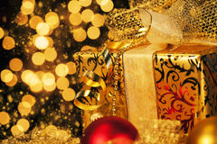 Golden christmas gift Royalty Free Stock Images