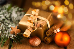 Golden Christmas gift with bokeh. Effect Stock Images