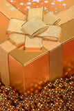 Golden Christmas gift box Royalty Free Stock Image