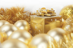 Golden christmas gift box, baubles and ornaments Stock Photo
