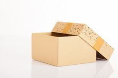 Golden christmas gift box with lid off. On white background Royalty Free Stock Image