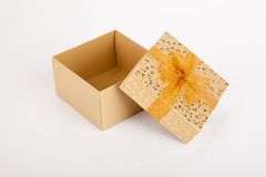 Golden christmas gift box with lid off. On white background Stock Images