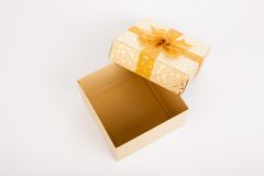 Golden christmas gift box with lid off. On white background Royalty Free Stock Photography