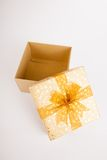 Golden christmas gift box with lid off. On white background Stock Photography