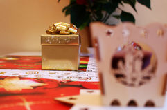 Golden christmas gift box with surprise inside. Photo of golden christmas gift box with surprise inside royalty free stock photos