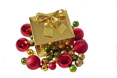 Golden christmas gift with ornaments Stock Photography