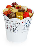 Golden Christmas gifts and dumps in decorative white bucket Royalty Free Stock Image