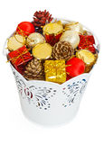 Golden Christmas gifts and dumps in decorative white bucket Stock Photography
