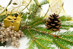 Golden christmas gifts with golden ribbon and needles fir with r Stock Photo