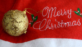 Golden Christmas glitter bauble on a xmas hat Royalty Free Stock Photo
