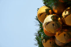 Golden Christmas globes with copyspace on left Stock Photography