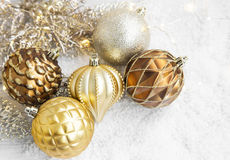 Golden Christmas Globes and Lights in the Snow Stock Images