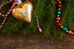 Golden christmas heart Stock Images