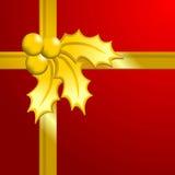 Golden Christmas holly gift Stock Photo