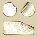 Golden Christmas  labels. And stickers with white border and snowflakes pattern Stock Images