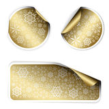 Golden Christmas labels and stickers. With white border and snowflakes pattern (vector Stock Photo