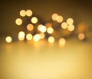 Golden christmas lights. Glowing lights on golden background Royalty Free Stock Photos