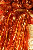 Golden christmas macro decoration, red background Royalty Free Stock Photos