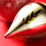 Golden christmas macro decoration, red background Royalty Free Stock Image