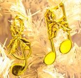 Golden Christmas music notes Stock Photos