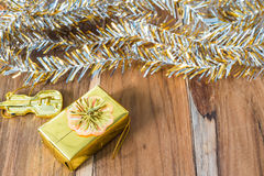Golden Christmas and New Year decoration on the wooden floor Royalty Free Stock Images