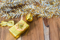 Golden Christmas and New Year decoration on the wooden floor Stock Image