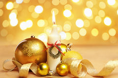 Golden Christmas ornament and candle Royalty Free Stock Images