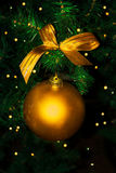 Golden Christmas ornament hanging Stock Photography