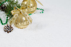 Golden Christmas Ornament on Snow Stock Images