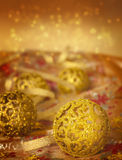 Golden Christmas ornaments Stock Photos
