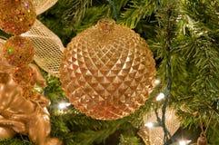 Golden Christmas ornaments. A closeup of several golden ornaments on a Christmas tree Stock Photography