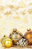 Golden Christmas ornaments background stock photography