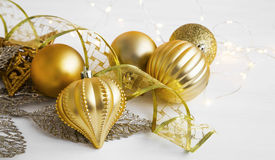 Golden Christmas ornaments. With balls, ribbon and lights royalty free stock photography