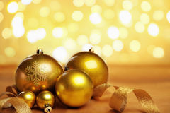 Golden Christmas ornaments with blur light Royalty Free Stock Image