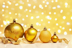 Golden Christmas ornaments with blur light Royalty Free Stock Images