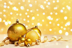 Golden Christmas ornaments with blur light Stock Image