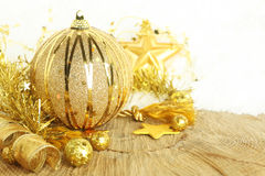 Golden Christmas ornaments. And decorations Stock Images