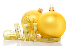 Golden christmas ornaments on white background Stock Image
