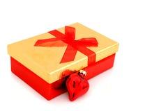 Golden christmas present Stock Photos