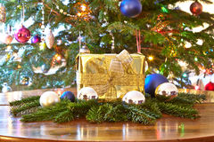 Golden christmas present and baubles, Christmas tree Stock Images