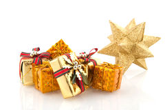 Golden christmas presents Royalty Free Stock Images