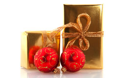 Golden christmas presents with red balls Stock Photography