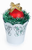 Golden Christmas red ball and the green garland in decorative wh Stock Images