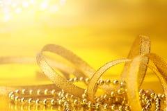 Golden christmas ribbon decorations for celebration background Stock Photography