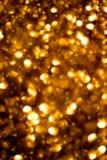 Golden Christmas shining glitter background with sparkling lig Royalty Free Stock Image