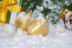 Golden Christmas on snow Stock Photo